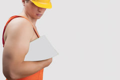 Portrait of a strong builder in helmet Stock Images