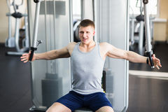 Portrait of a strong fit man in gym. Royalty Free Stock Photography