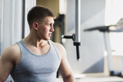 Portrait of a strong fit man in gym. Stock Photo