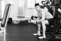 Portrait of a strong fit man in gym. Portrait of a strong fit young man exercising in a gym. Confident man looks ahead Stock Photography