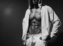 Portrait of strong healthy handsome Athletic Man Fitness Model posing near dark gray wall Royalty Free Stock Image