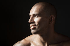Portrait of strong smiling man isolated on black background Royalty Free Stock Photo