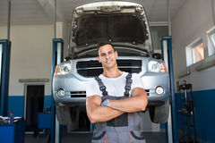 Portrait of strong smiling mechanic Stock Photography