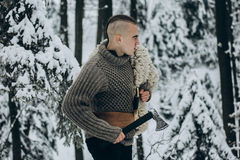 Portrait of strong viking warrior with mohawk haircut and wolf p Royalty Free Stock Photos