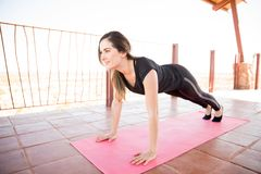 Strong woman doing some yoga royalty free stock images
