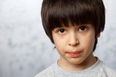 Portrait of a stubborn boy. Close up portrait of a stubborn boy Royalty Free Stock Photo