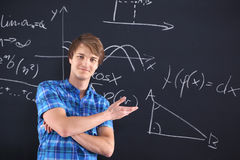 Portrait of a student at the blackboard background with patterns Royalty Free Stock Photo