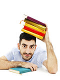 Portrait of student with books on the head Royalty Free Stock Photo
