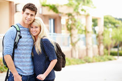 Portrait Of Student Couple Outdoors On University Campus Stock Photography