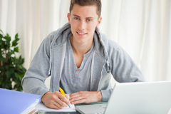 Portrait of a student doing his homework Stock Images
