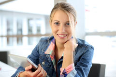 Portrait of student girl in class using tablet Stock Image