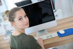 Portrait of student girl in front of computer Royalty Free Stock Images