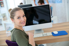 Portrait of a student girl in front of the computer Royalty Free Stock Images