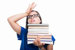 Portrait of student girl holding books looking exhausted Royalty Free Stock Images