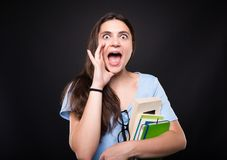 Portrait of student girl screaming out loud royalty free stock photography