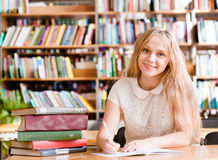 Portrait of a student girl studying at library Stock Photo