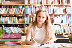 Portrait of a student girl studying at library Royalty Free Stock Images