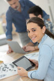 Portrait of student girl using tablet in class Stock Image