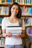 Portrait of a student holding books Stock Photo