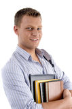 Portrait of student holding books. On an isolated white background Stock Photos