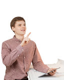 Portrait of student holding tablet and pointing in the air Stock Photo