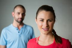 Portrait of student with instructor standing in yoga studio Stock Images