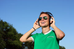 Portrait of student in a par. headphones and gl Stock Photography