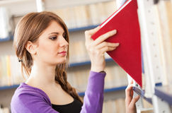 Student taking a book Royalty Free Stock Images