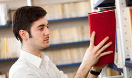 Student taking a book Stock Photos