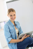 Portrait of student woman in classroom Royalty Free Stock Image