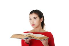 Portrait of student woman holding an open book Stock Photo