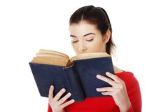 Portrait of student woman reading a book Stock Image