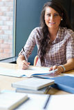 Portrait of a student working for an assignment Stock Image