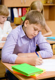 Portrait of student writing exam Stock Image