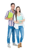 Portrait of students couple holding books Stock Photo