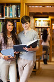 Portrait of students holding blue books Royalty Free Stock Photography