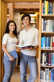 Portrait of students holding books Royalty Free Stock Images