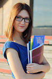Portrait of students with notebooks. Stock Photos