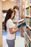 Portrait of students reading while standing up Stock Images