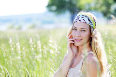 Portrait of stunning blond woman in meadow Royalty Free Stock Image