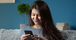 Portrait of stunning woman with mobile phone at home