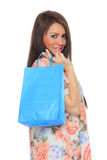 Portrait of stunning young woman carrying shopping bags Stock Photography