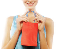 Portrait of stunning young woman carrying shopping bags Royalty Free Stock Image