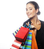 Portrait of stunning young woman carrying shopping bags Royalty Free Stock Photos