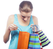 Portrait of stunning young woman carrying shopping bags Stock Photo