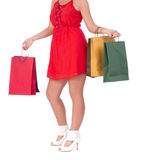 Portrait of stunning young woman with shopping bag. Portrait of stunning young woman carrying shopping bags against white background Royalty Free Stock Photography