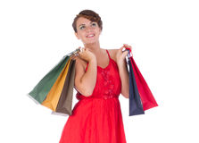 Portrait of stunning young woman with shopping bag. Portrait of stunning young woman carrying shopping bags against white background Stock Photography