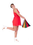 Portrait of stunning young woman with shopping bag. Portrait of stunning young woman carrying shopping bags against white background Royalty Free Stock Image
