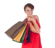 Portrait of stunning young woman with shopping bag. Portrait of stunning young woman carrying shopping bags against white background Royalty Free Stock Images