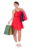 Portrait of stunning young woman with shopping bag. Portrait of stunning young woman carrying shopping bags against white background Stock Photo